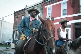 CONCRETE COWBOY - (L-R) Idris Elba as Harp and Caleb McLaughlin as Cole. Cr. Aaron Ricketts / NETFLIX © 2021 (Restricted Use)