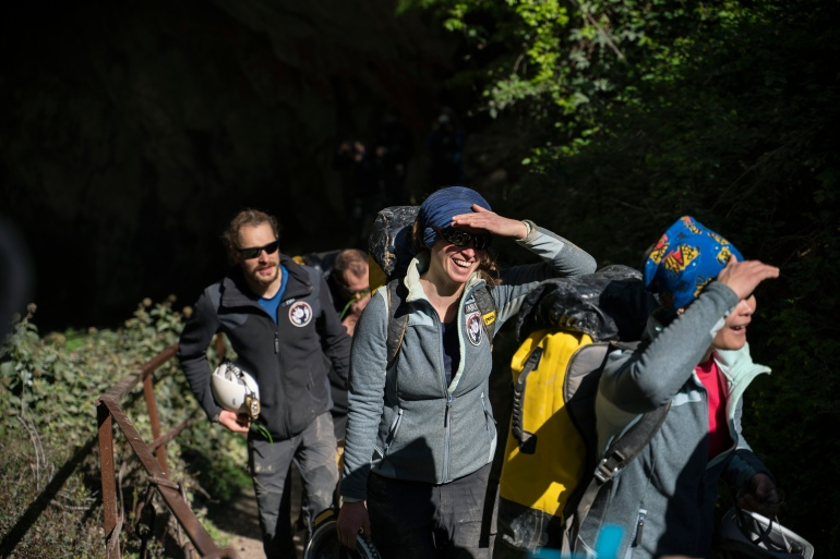 Members of the French team that participated in the Deep Time study walk out of the Lombrives Cave after 40 days underground [Renata Brito/AP Photo]