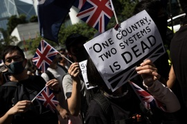 Pro-democracy protesters wave flags and chant slogans outside the UK embassy on September 15, 2019 in Hong Kong, China. The UK has opened up a British National Overseas (BNO) visa for those born in Hong Kong before 1997, when the territory was handed back to China [Chris McGrath/Getty Images]
