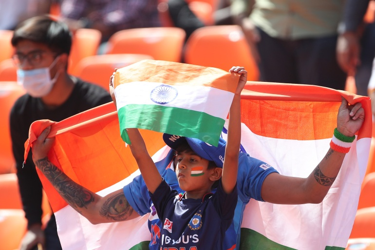 A fan watches the Test match between India and England at the Narendra Modi Stadium [File: Surjeet Yadav/Getty Images]