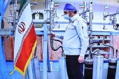 An engineer performs a mechanical test on nuclear equipment on Saturday [Iran President's Office]