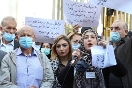 Parents of students abroad protest against the economic crisis in front of Lebanon's central bank in Beirut in November 2020 [Mohamed Azakir/Reuters]
