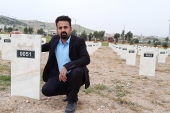 Qasm Kadhim inside the graveyard of Anfal victims in Chamchamal [Dana Taib Menmy/Al Jazeera]