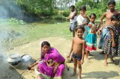Women and children outside their house at Sagar Island in the Sundarbans [Namrata Acharya/Al Jazeera]
