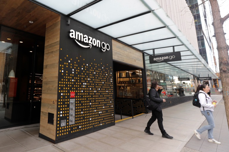 After the initial setup, which Amazon says takes less than a minute, shoppers can scan their hands at the register to pay for groceries without having to open their wallets [File: Ted S Warren/AP Photo]