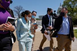 Representative Alexandria Ocasio-Cortez, centre left, on Tuesday reintroduced the 'Green New Deal' resolution, the Democrats' set of aggressive climate goals [File: Jonathan Ernst/Reuters]