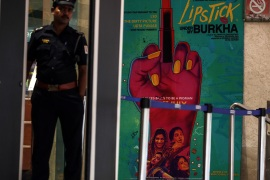 A security person stands at the entrance to a cinema playing Lipstick Under My Burkha in Mumbai [File: Divyakant Solanki/EPA]