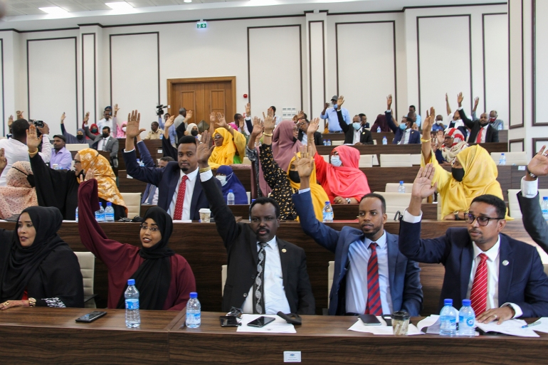 Somali members of parliament vote to extend the term of the president for an additional two years [Said Yusuf Warsame/EPA]