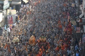 Devotees on their way to take a holy dip in the Ganges River during the Kumbh Mela at Haridwar, Uttarakhand on April 14, 2021 [File: Idrees Mohammed/EPA]