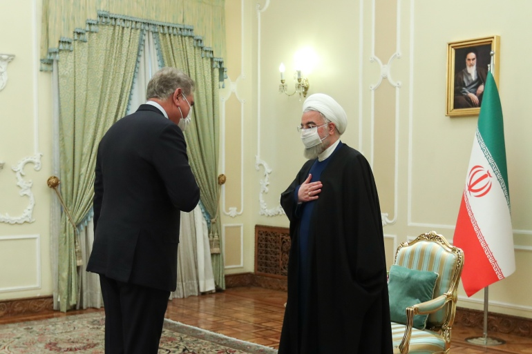 Iranian President Hassan Rouhani, right, welcomes Pakistani Foreign Minister Qureshi, at the presidential office in Tehran [Iranian presidential office handout/EPA]