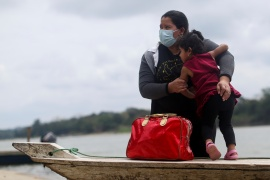 A Honduran migrant family trying to reach the U.S. get on a boat to cross the Usumacinta river, at La Tecnica in Lacandon jungle, Guatemala, March 7, 2021 (REUTERS/Edgard Garrido) (Reuters)