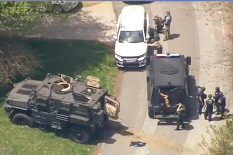 Law enforcement in standoff with suspected gunman in Boone, North Carolina [Screen grab via WSOC-TV]