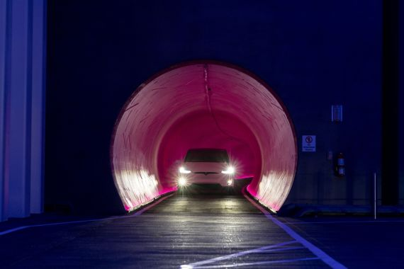 Tesla vehicles capable of carrying up to 16 passengers will shuttle through this Las Vegas tunnel once it is operational, turning an 0.8km (1.5-mile) walk on the surface into a trip that takes a couple of minutes [File: Bloomberg]
