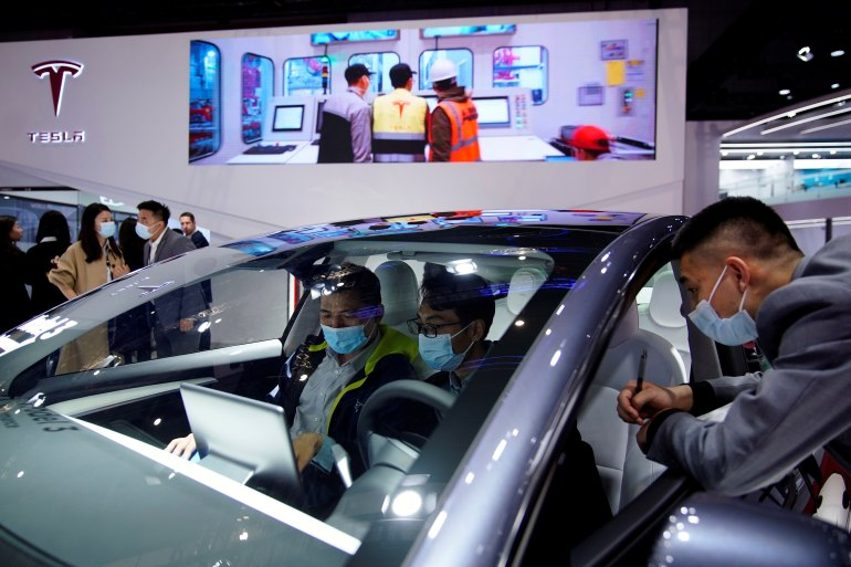 Tesla's unusual public apology followed criticism in China's state media and an incident at the Shanghai auto show where an unhappy customer clambered atop a Tesla to protest the company's handling of her complaints about malfunctioning brakes [File: Aly Song/Reuters]