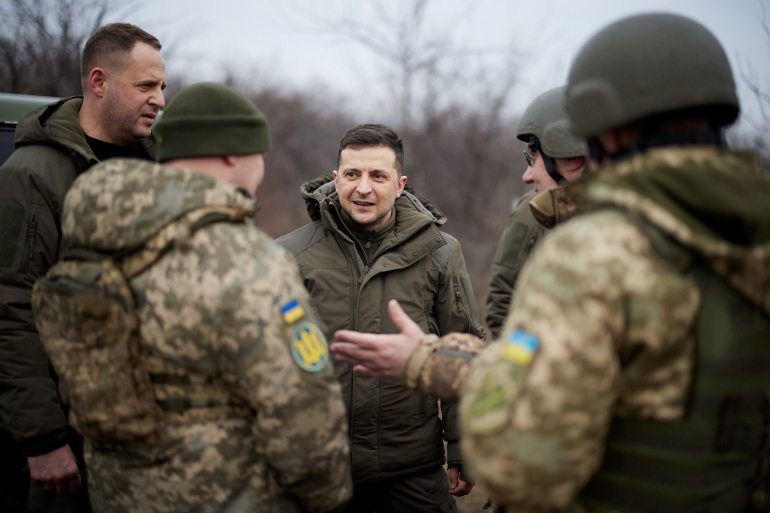 Ukraine's President Volodymyr Zelenskyy (centre) said that in a Friday phone call that lasted 50 minutes, US President Joe Biden assured him 'Ukraine will never be left alone against Russia's aggression' [File: Ukrainian Presidential Press Service via Reuters]