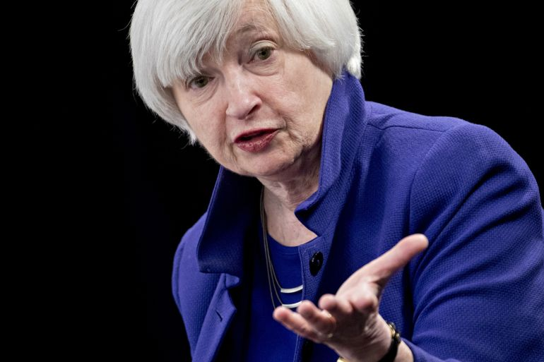 United States Treasury Secretary Janet Yellen said on Monday that a minimum global corporate tax rate will help ensure that everyone pays their share in funding public projects, but critics of the proposal argue that the burden of higher taxes will fall mostly on workers and only drive away corporations and investment [File: Andrew Harrer/Bloomberg]