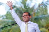 Nasheed waves to supporters following his return from exile on November 1, 2018 [File: Ahmed Shurau/AFP]