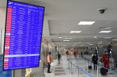 A flight board showing scheduled flights at the Jomo Kenyatta International Airport in Nairobi [File: Simon Maina/AFP]