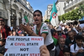 Mass protests erupted in February 2019 after then-President Abdelaziz Bouteflika said he would run for a fifth term, bringing hundreds of thousands onto the streets [File: Ryad Kramdi/AFP]