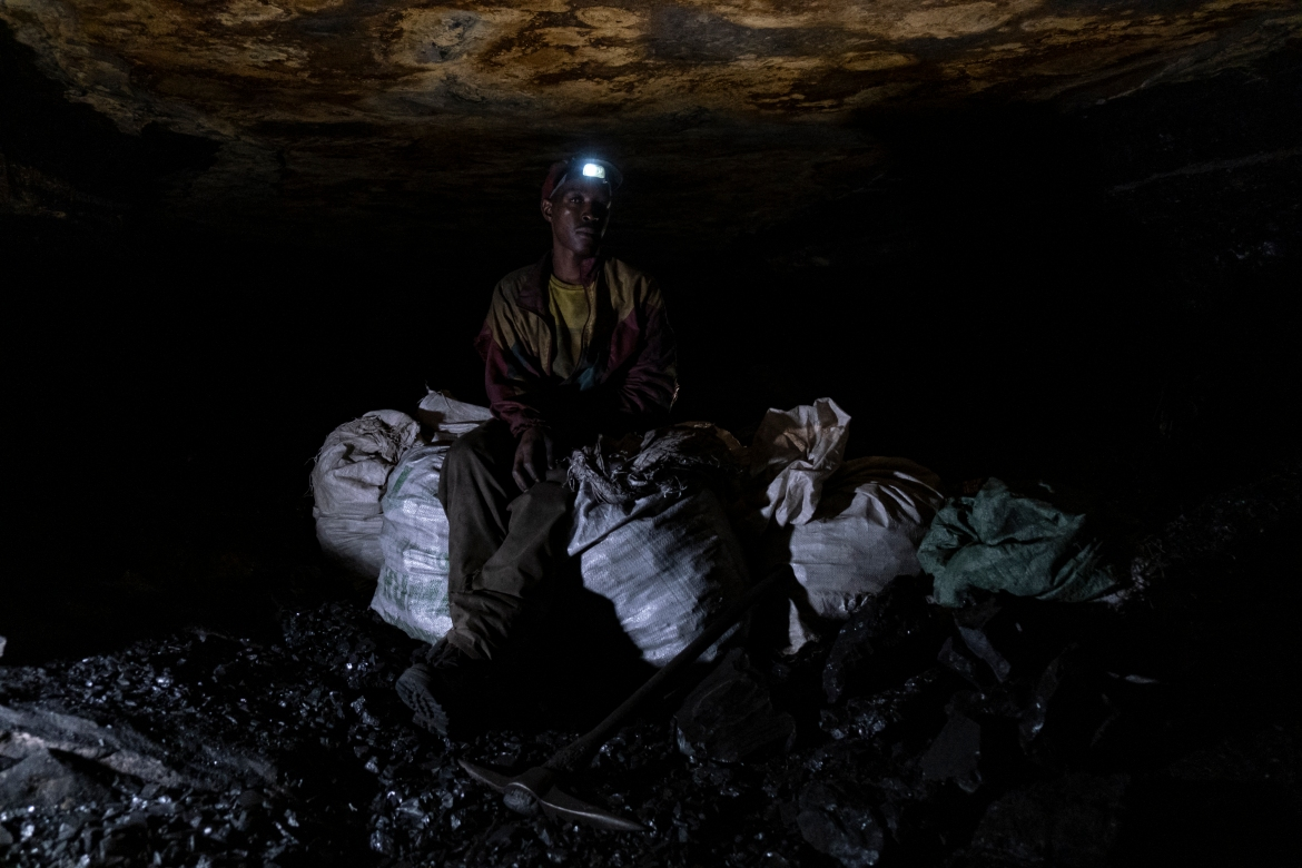 After skidding down 82 steps at Goldview coalmine and making his way through a narrow tunnel, Mhlanga reached a black vein in the rock some two metres wide where he would remain overnight, breaking off and collecting coal, rarely allowing himself to rest. [Emmanuel Croset/AFP]