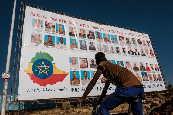 A sign in Bahir Dar, Ethiopia that depicts members of the Tigray People's Liberation Front wanted by the Ethiopian police [File: Eduardo Soteras/AFP]
