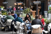 People have been allowed to eat and drink outside since the first relaxation of rules in April [File: Daniel Leal-Olivas/AFP]