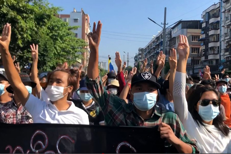 Protesters making the three-finger salute as they take part in a flash mob on 'Global Myanmar Spring Revolution Day' in Yangon [AFP TV/ AFP]