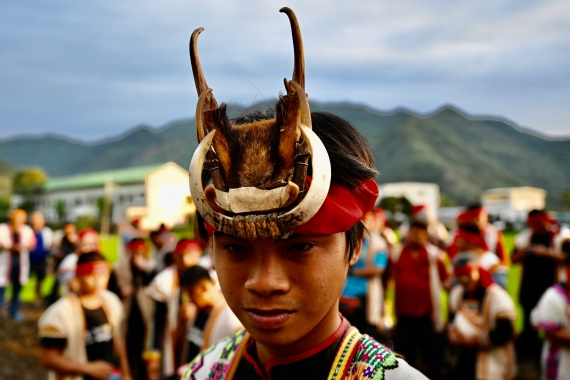 A young Indigenous priest surrounded by clansmen during a festival at a village in Taiwan's Taitung county [Sam Yeh/AFP]