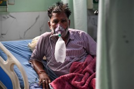 A coronavirus patient breaths with the help of an oxygen mask inside the Intensive Care Unit (ICU) of Teerthanker Mahaveer University Hospital in Moradabad, Uttar Pradesh [File: Prakash Singh/AFP]