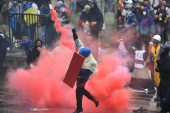 Demonstrators clash with riot police during a protest against President Ivan Duque's government at Bolivar Square in Bogota on May 5 [Juan Barreto/AFP]