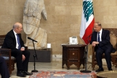 Lebanon's President Michel Aoun, right, receives French foreign minister Jean-Yves Le Drian at the presidential palace in Baabda [Joseph Eid/Dalati and Nohra/AFP]