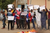 Protesters in N'Djamena carry banners with anti France slogans [Djimet Wiche/AFP]