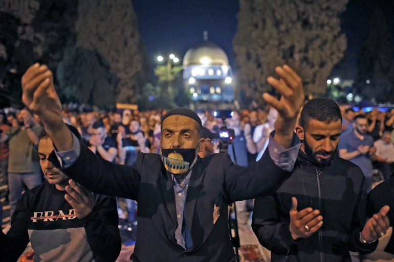 Palestinian worshippers pray on Laylat al-Qadr outside the Dome of the Rock in occupied East Jerusalem's Al-Aqsa Mosque compound [Ahmad Gharabli/AFP]