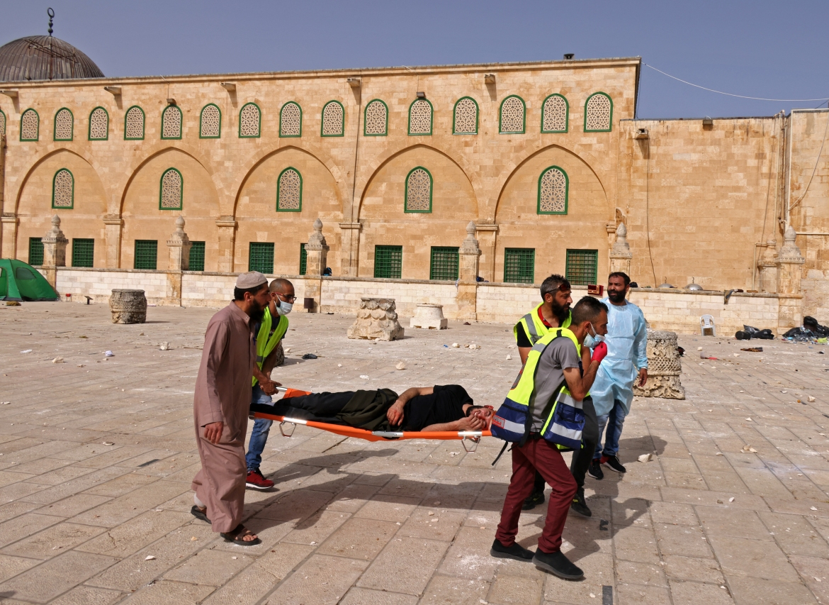 Monday's violence at the Al-Aqsa compound came after days of mounting tensions between Palestinians and Israeli forces in the Old City of Jerusalem. [Ahmad Gharabli/AFP]