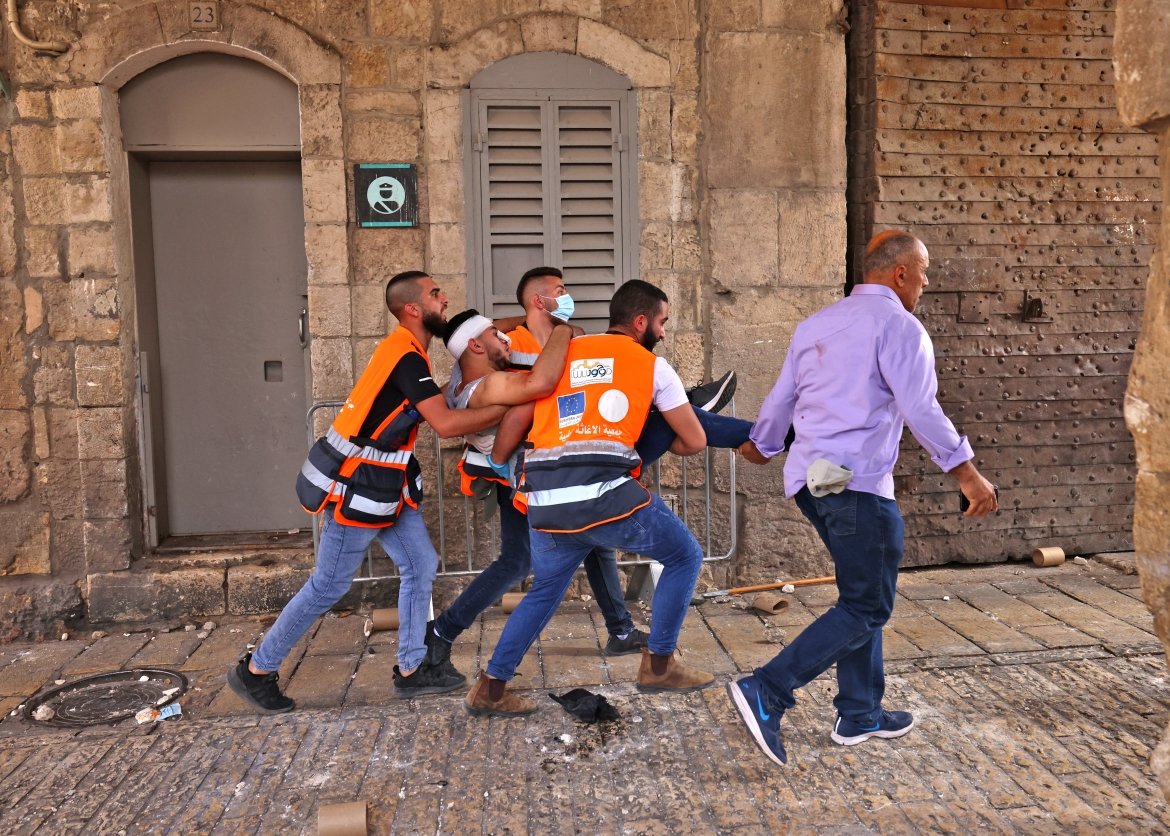 The Palestinian Red Crescent says 180 Palestinians have been wounded and its medical teams were prevented from accessing the scene of the violence. At least 80 people were hospitalised. [Emmanuel Dunand/AFP]