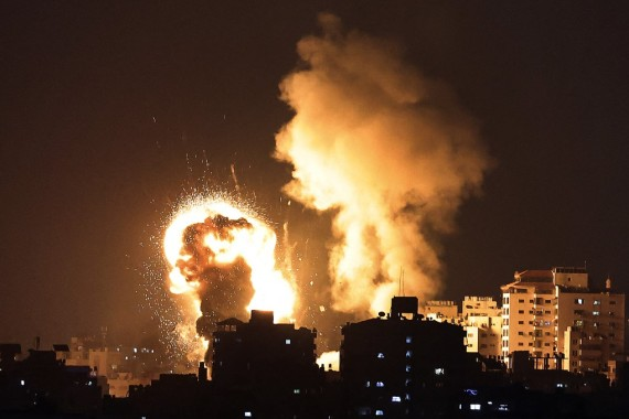 Israeli air strikes hit the Gaza Strip on Monday night in response to a barrage of rockets fired by Hamas amid spiralling violence sparked by unrest at Jerusalem's Al Aqsa Mosque compound [Mahmud Hams/AFP]