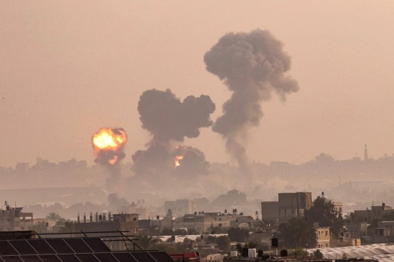 A fire billows from Israeli air strikes in Khan Yunis, in the southern Gaza Strip on Tuesday morning [Said Khatib/AFP]