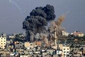Smoke billows from Israeli air strikes in Gaza City [Anas Baba/AFP]