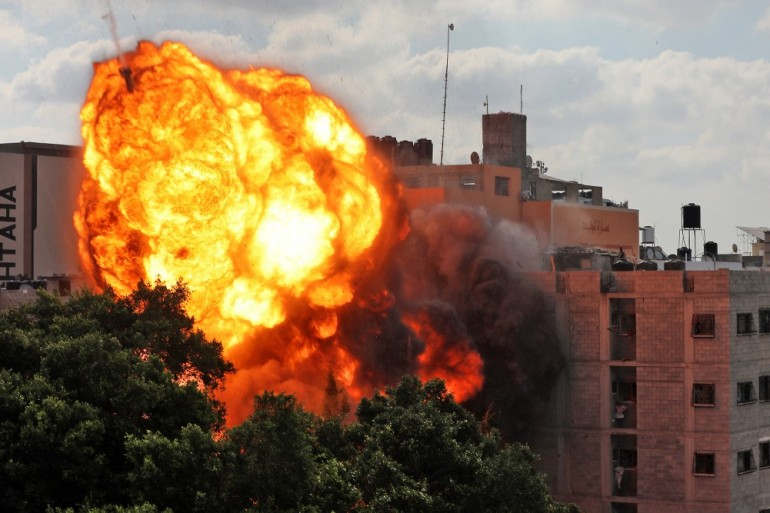 A ball of fire engulfing the al-Walid building which was destroyed in an Israeli air strike on Gaza city [AFP]
