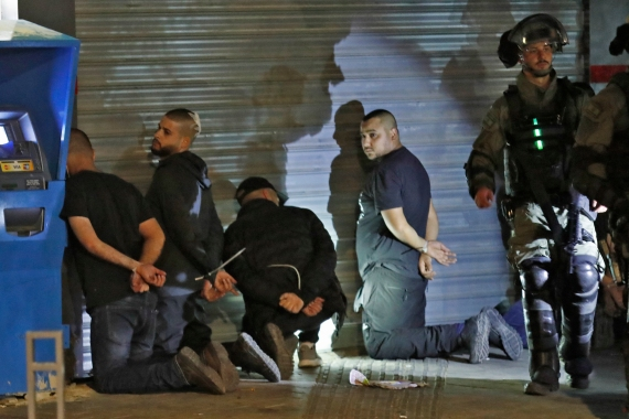 Israeli police say some 1,550 Palestinian citizens of Israel have been arrested since May9 [Ahmad Gharabli/AFP]