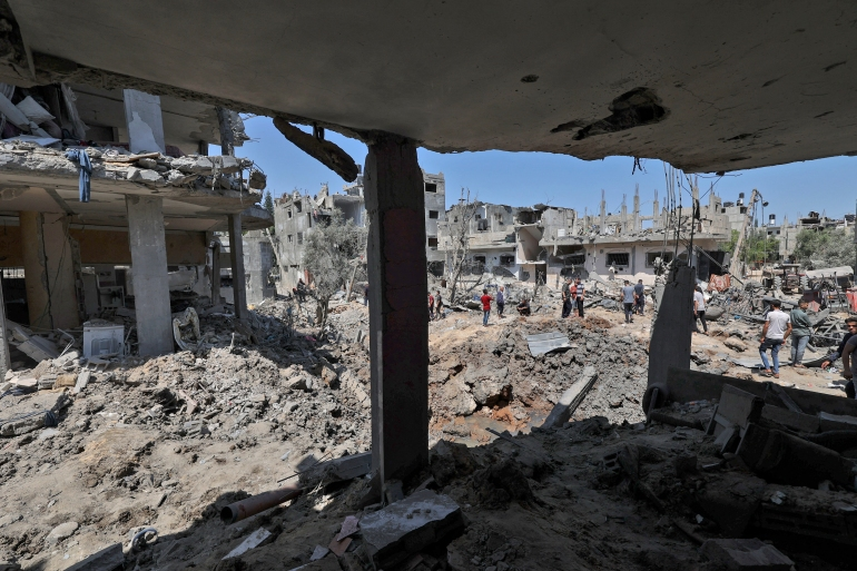 Palestinians assess the damage caused by Israeli air strikes, in Beit Hanoun in the northern Gaza Strip [Mahmud Hams/AFP]