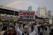 People take part in a protest against the hosting of the 2020 Tokyo Olympic Games in Tokyo on May 17, 2021 [Charly Triballeau/ AFP]
