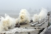 Waves lash over onto a shoreline in Mumbai, in Maharashtra state[Sujit Jaiswal/AFP]