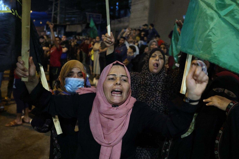Women in Rafah, in the southern Gaza Strip, celebrate the ceasefire. [Said Khatib/AFP]