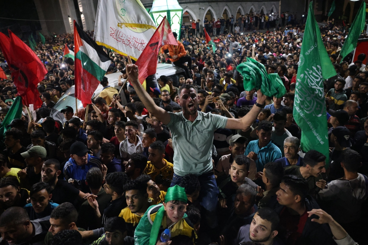 Thousands took to the streets of Gaza as the ceasefire took hold at 2am. [Said Khatib/AFP]