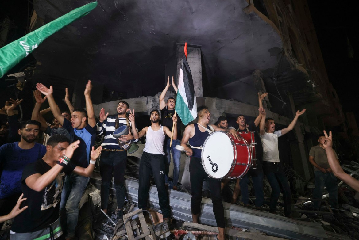 Hamas said Israel must end its violations in occupied East Jerusalem and address damages from the bombardment of Gaza following the ceasefire. [Mahmud Hams/AFP]
