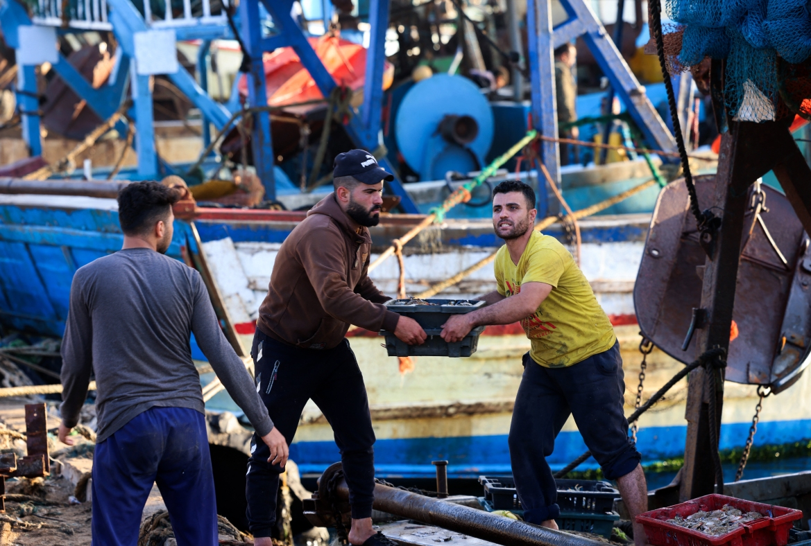 Israeli security forces allowed a limited number of vessels to return to sea following the ceasefire. [Emmanuel Dunand/AFP]
