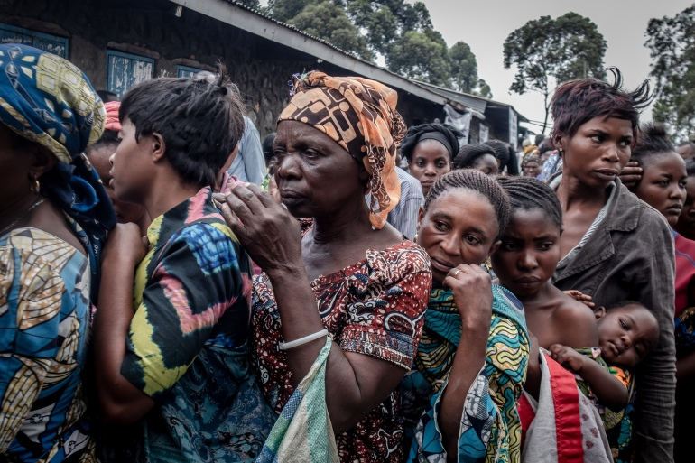 Displaced residents wait to register to receive aid distributed by a local politician and businessman in Goma [Guerchom Ndebo/AFP]