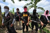 The BIFF is opposed to the peace agreement in southern Philippines between the main Muslim rebel group, Moro Islamic Liberation Front (MILF) and the central government, leading to their breakaway [File: Ted Aljibe/AFP]