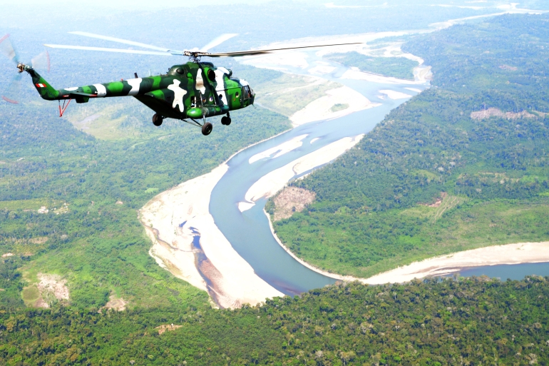 This file photo shows a Peruvian Army helicopter flying over the VRAEM area, between the rivers Ene, Apurimac and Mantaro, where authorities say 75 percent of cocaine is produced in Peru [File: Cris Bouroncle/AFP]